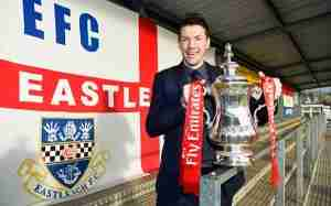 EASTLEIGH, ENGLAND - JANUARY 05:  Chris Todd manager of Eastleigh poses with the Fa Cup trophy during an Eastleigh media day ahead of the Emirates FA Cup third round match against Bolton Wanderers at The Silverlake Stadium on January 5, 2016 in Eastleigh, England.  (Photo by Mike Hewitt/Getty Images)